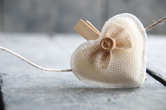 Heart hanging on rope, Blurred photo for the background. Stock Photo