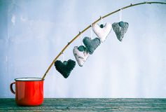 Heart hanging twig red cup Royalty Free Stock Photo