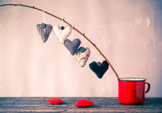 Heart hanging twig red cup Stock Photos