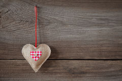 Heart hanging on wooden board Stock Photo