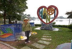 Heart of Hanoi at West Lake. A typical Vietnamese salesman at the Hanoi logo -  Vietnam Royalty Free Stock Photo