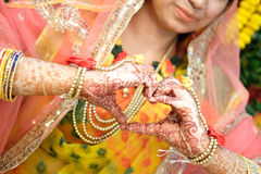 Heart hape of Hands of an Indian bride painted with henna Royalty Free Stock Photography
