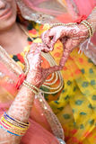 Heart hape of Hands of an Indian bride painted with henna Stock Images