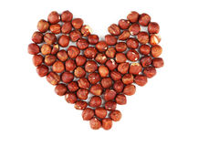 Heart from hazelnuts isolated on white. Stock Photo