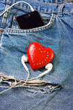 Heart and headphones Stock Photos