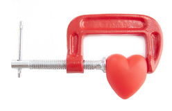 Heart healing concept. Red heart in the vice tool Royalty Free Stock Photo