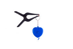 heart healing concept - blue heart in the plastic clamp on white Stock Images