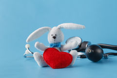 Heart healthcare concept, thonometer and toy heart on blue backg Stock Images
