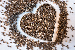 Heart Healthy Chia Seeds. Chia seeds shaped like a heart Royalty Free Stock Photography