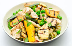 A heart healthy meal of pea pesto pasta with chicken and grilled Stock Images