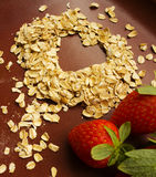 Heart Healthy Oats. Oats with a heart shape and some strawberries Royalty Free Stock Photo
