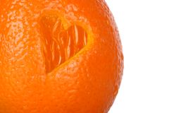 Heart healthy orange. An orange with a heart cut in the side of it Stock Photo