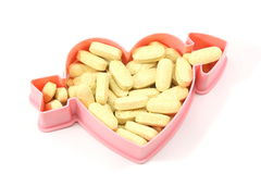 Heart Healthy Vitamins. Vitamins in the shaper of a heart to show the healthiness Stock Photo