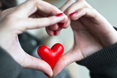 Heart in heart. Heart of hands and small heart inside Stock Image