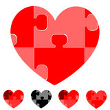 Heart and hearts with red grey black puzzles. Stock Photography