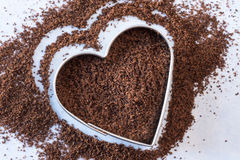 Heart heathy cloves. Ground cloves in the shape of a heart Stock Image