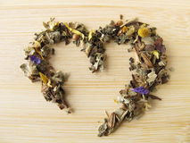 Heart of herbal tea with mountains herbs Stock Photos