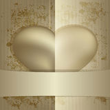 Heart hidden behind the ribbon Royalty Free Stock Photography
