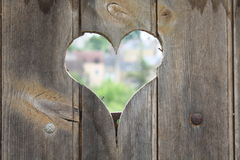 Heart hole. In a wood door stock photography