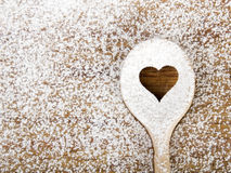 Heart hole spoon on the wooden pastry board Royalty Free Stock Photos