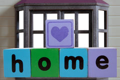 Heart on home in frame Stock Image