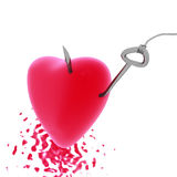 Heart on a hook. Red heart pierced by a metal hook Stock Image
