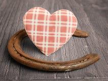 Heart and  horseshoe Stock Photos