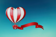 Heart hot air balloon. Hot air balloon in the shape of a heart in the sky Royalty Free Stock Photos