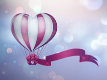 Heart hot air balloon. Hot air balloon in the shape of a heart in the sky royalty free illustration