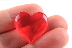 Heart in the human fingers Stock Photo