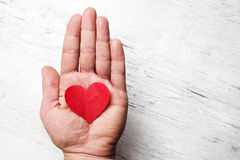 Heart in human hand Royalty Free Stock Images