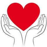 Heart in human hands Royalty Free Stock Images