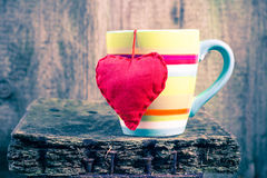 Heart hung colored cup Royalty Free Stock Images