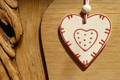 Heart hung on wooden door Stock Photo