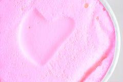 Heart ice-cream. Heart shape pink ice-cream texture Royalty Free Stock Photo