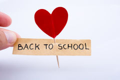 Heart icon and school Royalty Free Stock Images