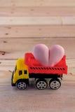 Heart icon on vehicle bucket transportation Stock Photo