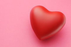 Heart. Image of red heart on pink paper Royalty Free Stock Images