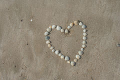 Heart image on sand of beach. Heart image on sand of beach that make from shell Stock Image