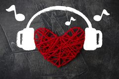 Free Heart In Headphones On A Dark Background. Theme For Valentine`s Day. Wedding, Love Stock Images - 109566034