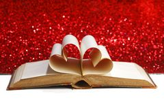 Heart inside a book Stock Photos