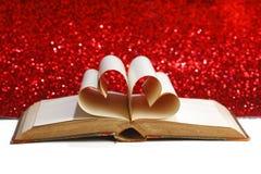 Heart inside a book Stock Photos