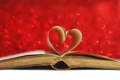 Heart inside a book Stock Images
