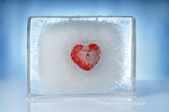 Heart inside ice block. Heart inside melting block of ice Royalty Free Stock Photos