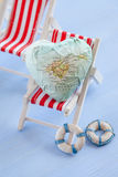 Heart with the island of Mallorca. On striped beach chair Stock Image