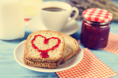 Heart of jam on a toast, with a cross-process effect Royalty Free Stock Images