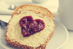 Heart of jam on a toast Stock Images
