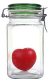 Heart in a jar. Red heart symbol in a closed glass jar isolated on white Royalty Free Stock Images