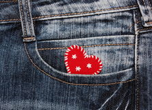 Heart in jeans pocket Royalty Free Stock Photos