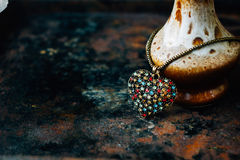 Heart jewellery on black rustic surface. Royalty Free Stock Images